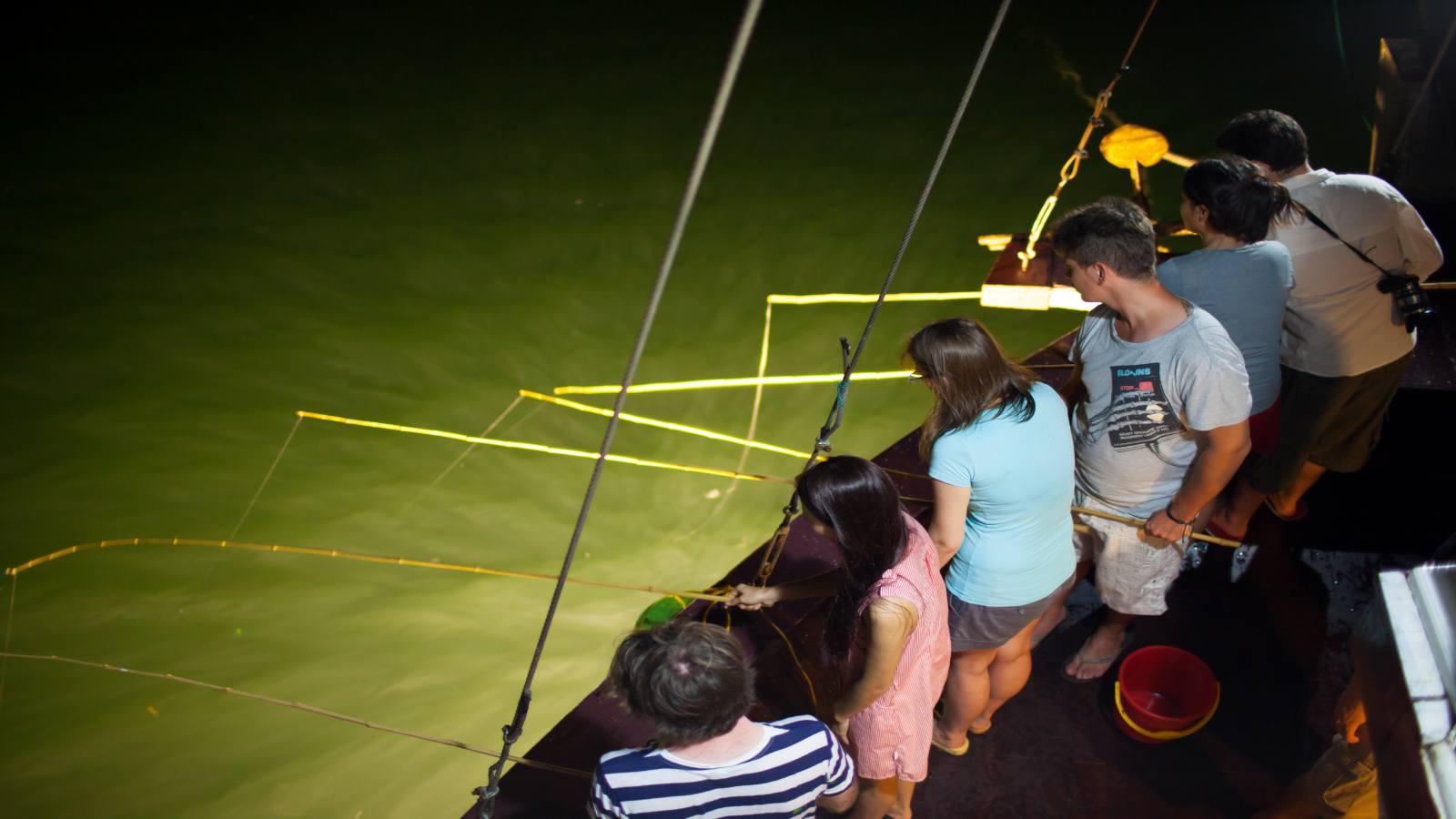 Tourists enjoy squid fishing on Lan Ha Bay
